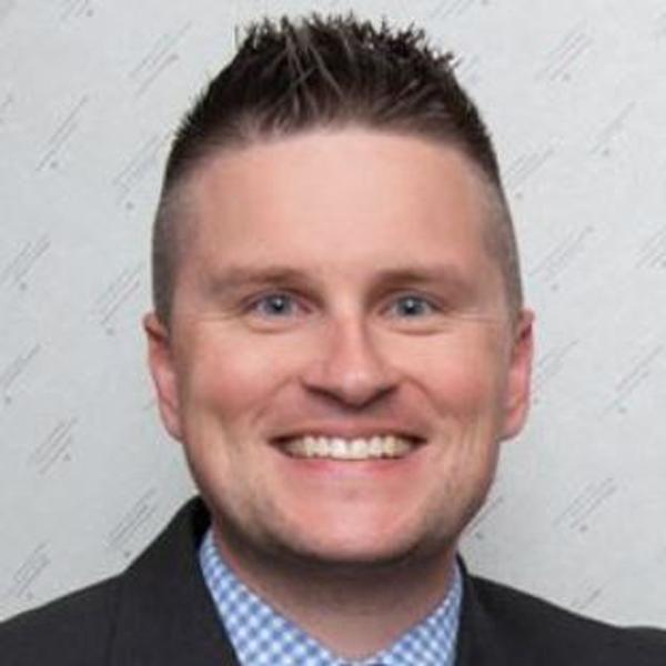 Chris Miller smiling.