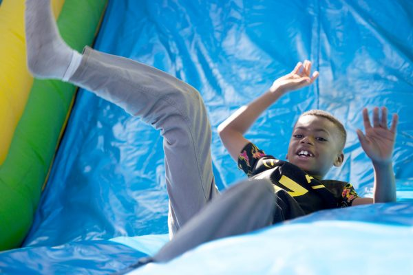 Young boy going down the slide at a United Way Rock Hill SC event.