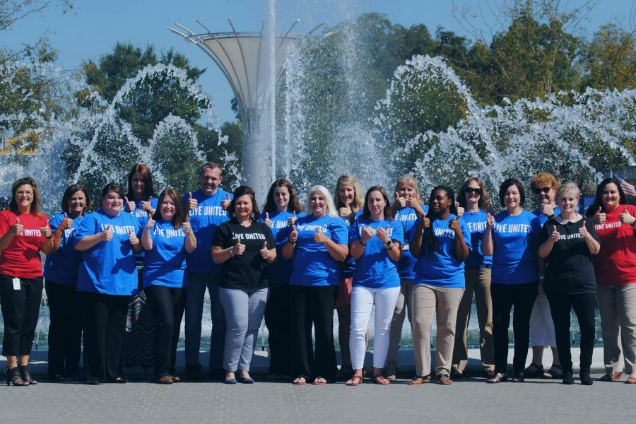 United Way of York County, SC volunteers giving thumps up by a water fountain