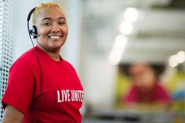 Young women wearing red live united shirt from United Way of York County, SC