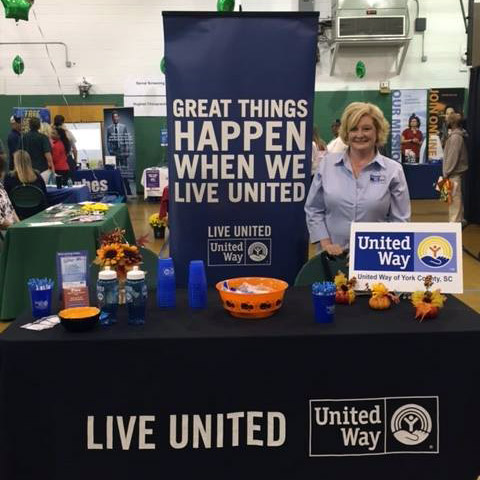 Rebecca Melton standing at a booth during a United Way Rock Hill SC event.