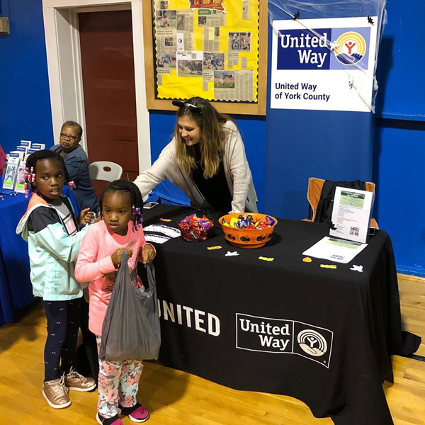 two little girls standing at a booth during a United Way of York County, SC event.