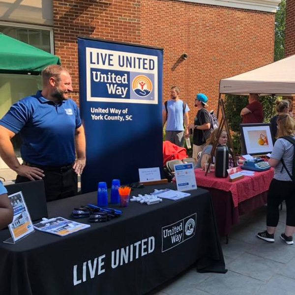 United Way of York, SC standing at booth during community event.